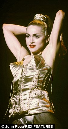 Madonna in the iconic cone bra via Daily Mail