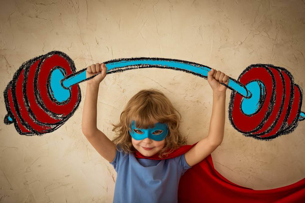 A beautiful image of a young girl feeling strong via Straight.com from an article about young girls influenced by media.